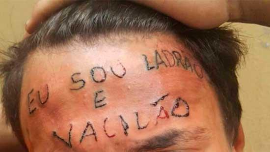 """O jovem Ruan Rocha da Silva, de 19 anos, que teve a frase """"Eu sou ladrão e vacilão"""" tatuada à força em 2017, foi condenado nesta terça-feira, 11, a quatro anos e oito meses de prisão em regime semiaberto"""